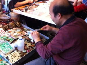 Man polishing piece of jade